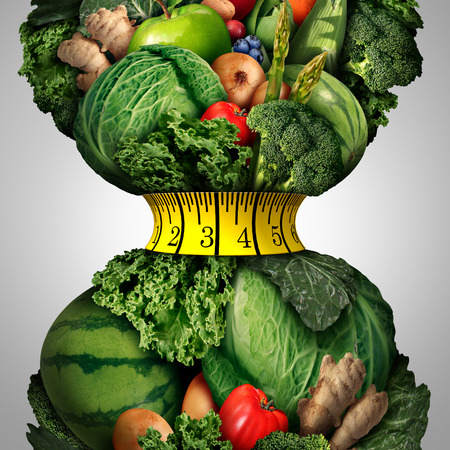 Foto de Healthy weight loss diet as a group of fresh fruits and vegetables with a fitness tape measure wrapped around a tight shrinking waistline shape as a metaphor for healthy lifestyle weightloss. - Imagen libre de derechos