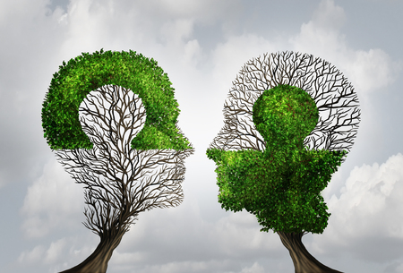 Photo pour Perfect business partnership as a connecting puzzle shaped as two trees in the form of human heads connecting together to complete each other as a corporate success metaphor for cooperation and agreement as equal partners. - image libre de droit