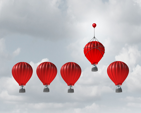 Photo pour Competitive edge and business advantage concept as a group of hot air balloons racing to the top but an individualleader with a small balloon attached giving the winning competitor an extra boost to win the competition. - image libre de droit