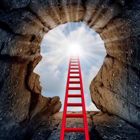 Foto de Concept of open mind as a a deep mountain cliff shaped as a human head with a ladder leading to the outside towards a glowing sun as a psychology and mental health metaphor for spiritual discovery. - Imagen libre de derechos