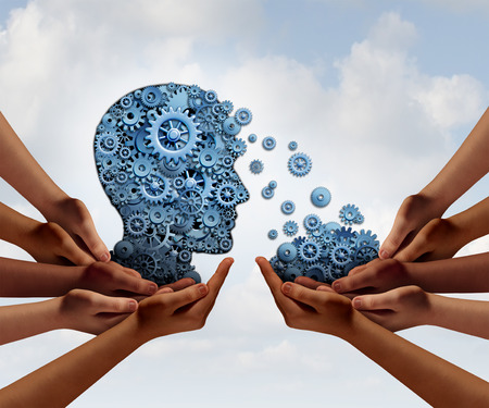 Foto de Group training and skill development business education concept with many diverse hands holding a bunch of gears transferring the wheels to a human head made of cogs as a symbol of acquiring the tools for team learning. - Imagen libre de derechos