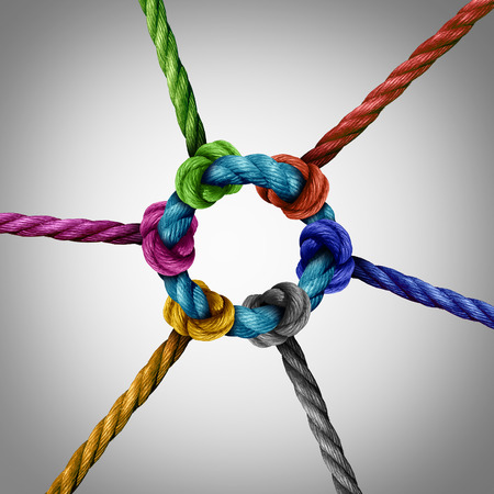 Foto de Central network connection business concept as a group of diverse ropes connected to a circle central rope as a network metaphor for connectivity and linking to a centralized support structure. - Imagen libre de derechos