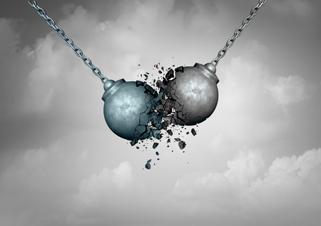 Foto de Destructive competition business concept as two wrecking balls colliding together resulting in smashed breakup as a rivalry struggle metaphor as a 3D illustration. - Imagen libre de derechos