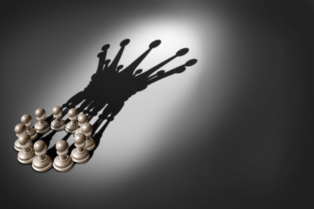 Foto de Business concept Leadership team and group concept as an organized company of chess pawn pieces joining forces and working together united and as one in agreement to cast a shadow shaped as a king crown 3D render. - Imagen libre de derechos