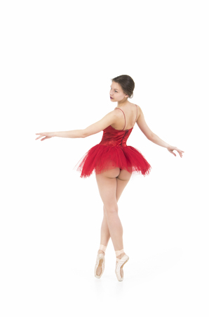 Photo pour A girl in a red tutu dancing ballet. Studio shot on white background, isolated image. - image libre de droit