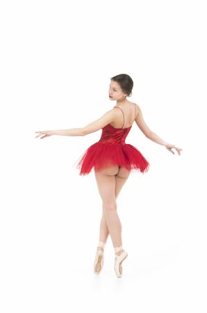 Foto de A girl in a red tutu dancing ballet. Studio shot on white background, isolated image. - Imagen libre de derechos
