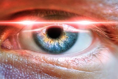 Photo pour Male eye scanned for secure identifiation or concept for medicial iris correction. - image libre de droit