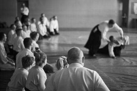 Photo pour Aikido training. Black and white image. The teacher shows reception.  Traditional form of clothing in Aikido. - image libre de droit