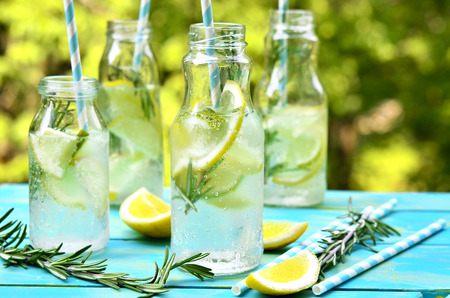 Foto de Citrus fizz with rosemary in a bottle. - Imagen libre de derechos