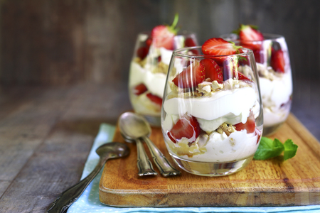 Photo for Delisious traditional english dessert eton mess with strawberry on a wooden background. - Royalty Free Image