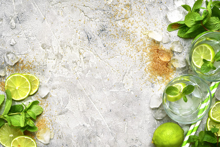 Foto de Ingredients for making mojito on a  grey concrete, stone or slate  background.Top view with space for text. - Imagen libre de derechos