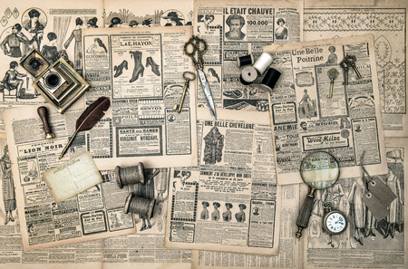 Foto de antique accessories, sewing and writing tools, vintage fashion magazine for the woman  retro style toned picture - Imagen libre de derechos