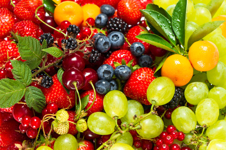 Photo for mix of fresh fruits and berries  raw food ingredients  nutrition background - Royalty Free Image