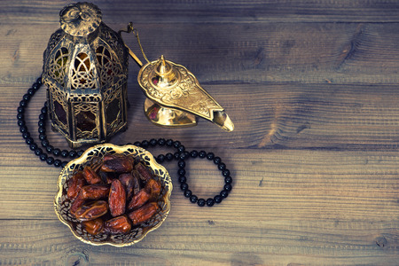 Photo for Dates, arabian lantern and rosary. Islamic holidays concept. Ramadan decoration. Retro style toned picture - Royalty Free Image
