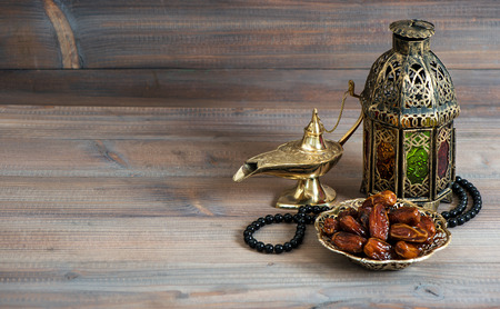 Photo for Dates, arabian lantern and rosary. Islamic holidays concept. Ramadan decoration - Royalty Free Image