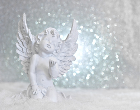 Photo for little white guardian angel in snow on shiny lights background. christmas decoration - Royalty Free Image