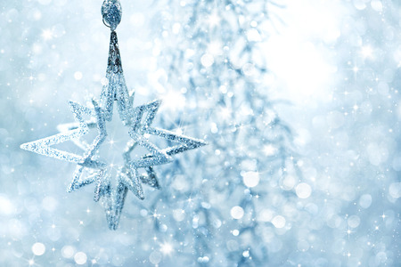 Photo for Winter blue background shiny silver star with blinking lights - Royalty Free Image