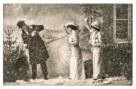 Photo pour happy young people playing in snow. vintage christmas holidays picture with original scratches and film grain - image libre de droit