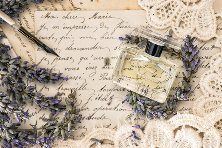 Photo for perfume, lavender flowers, vintage ink pen and old love letters. retro style toned picture - Royalty Free Image