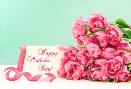 Photo for Pink tulips and greeting card with sample text Happy Mothers Day! - Royalty Free Image