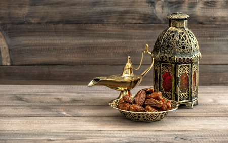Photo for Ramadan lamp and dates on wooden background. Festive still life with oriental lantern - Royalty Free Image