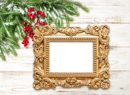 Foto de Christmas decoration with golden picture frame on wooden background. Winter holidays - Imagen libre de derechos