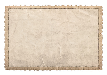Foto de Old paper frame with carved edges for photos and pictures. Used cardboard texture isolated on white background - Imagen libre de derechos