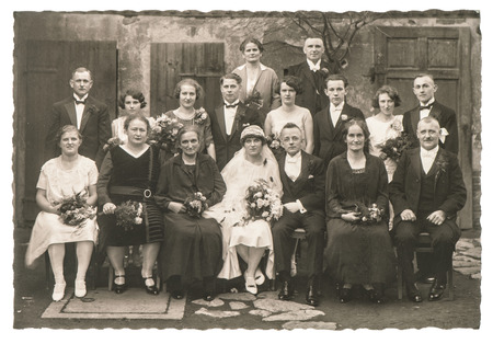 Photo for BERLIN, GERMANY - CIRCA 1936: Old family wedding photo. People wearing vintage clothing. Antique fashion dress - Royalty Free Image