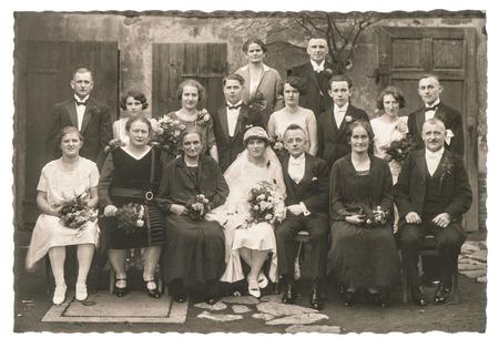 Foto de BERLIN, GERMANY - CIRCA 1936: Old family wedding photo. People wearing vintage clothing. Antique fashion dress - Imagen libre de derechos