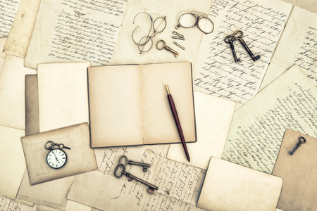 Photo for Old letters and postcards, open journal, vintage accessories. Used paper background - Royalty Free Image