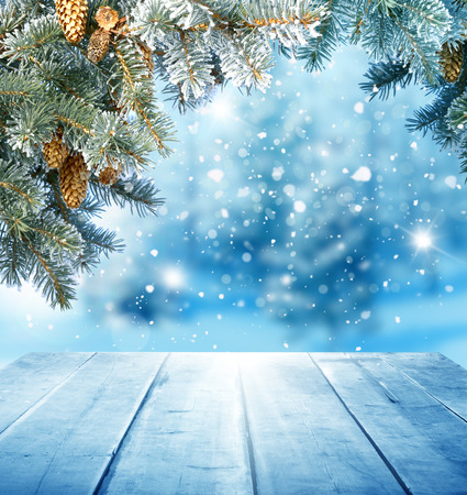Foto de christmas background with wooden table - Imagen libre de derechos