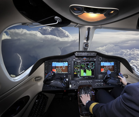 Photo pour A beautiful view of a thunderstorm from the cockpit - image libre de droit