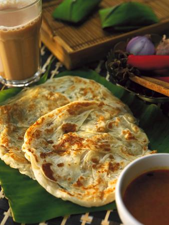 Photo pour Roti canai and teh tarik - image libre de droit