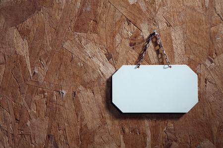 Foto de metal signage with string on the texture wood - Imagen libre de derechos