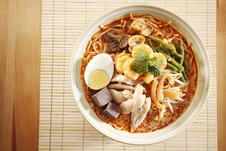 Foto de Top view of malaysian food bowl of the curry noodle - Imagen libre de derechos