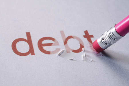 Foto de pencil erasing the word-debt - Imagen libre de derechos