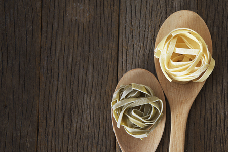 dry pasta on the wooden table