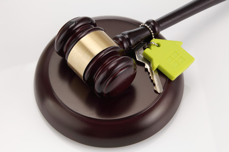 Foto de Gavel wooden and house for home buying or selling of bidding or lawyer of home real estate and building concept. - Imagen libre de derechos