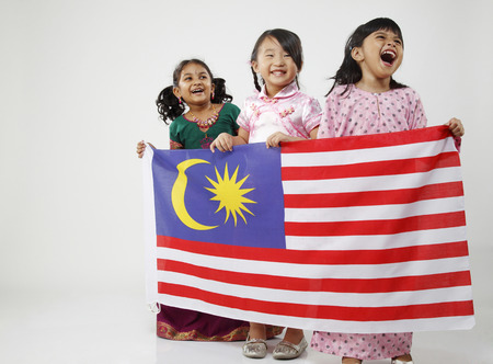 Photo pour Three girls holding flag - image libre de droit