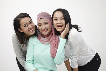Photo pour Harmony malaysian happy laughing at camera - image libre de droit