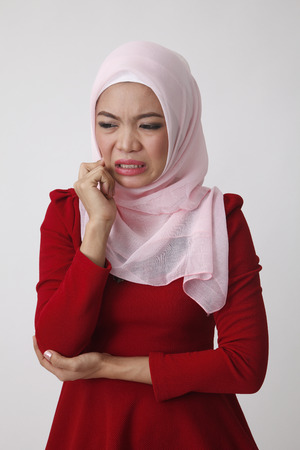 Photo for malay woman not feeling well - Royalty Free Image