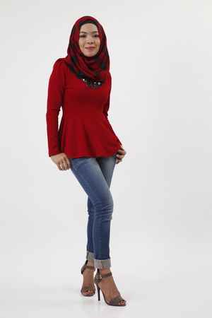 Photo for full length of malay woman with red tudung posing - Royalty Free Image