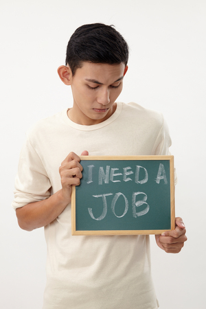 Photo for malay teenage holding a message that his need jobs - Royalty Free Image