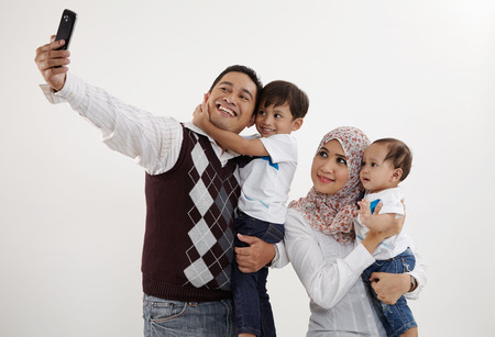 Photo pour family of four looking taking selfie - image libre de droit