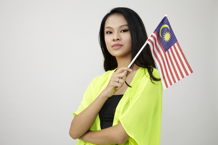 Photo pour chinese woman holding a malaysia flag on the white background - image libre de droit
