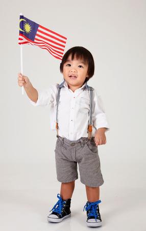 Foto für chinese boy holding malaysia flag - Lizenzfreies Bild