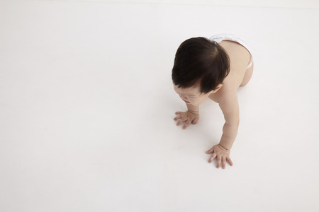 Photo pour top view of chinese baby girl crawling - image libre de droit
