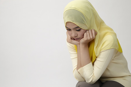 Photo for unhappy woman sitting looking down - Royalty Free Image