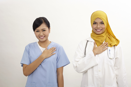 Photo for asian nurse and doctor with welcome hand sign on the white background - Royalty Free Image