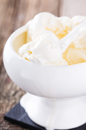 Photo for Ice cream, white cream in a white ceramic bowl.selective focus - Royalty Free Image
